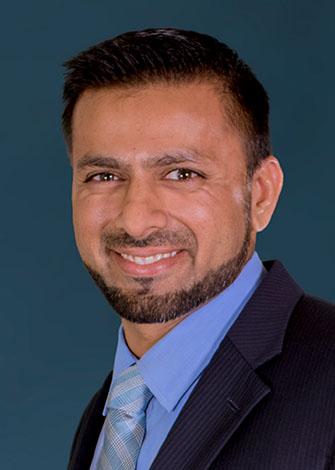 a headshot of Arif Shaik