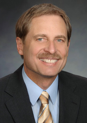 a headshot of Peter Hansel